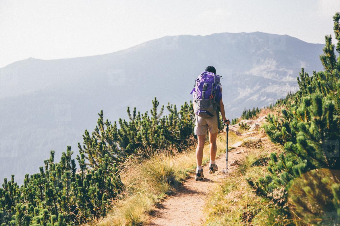 Girl hiking a mountain