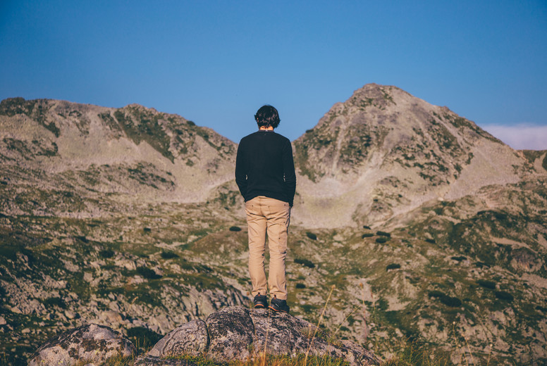 Young man hiking a mountain