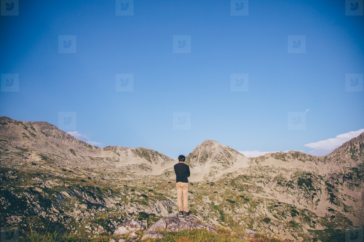 Young man hiking a mountain