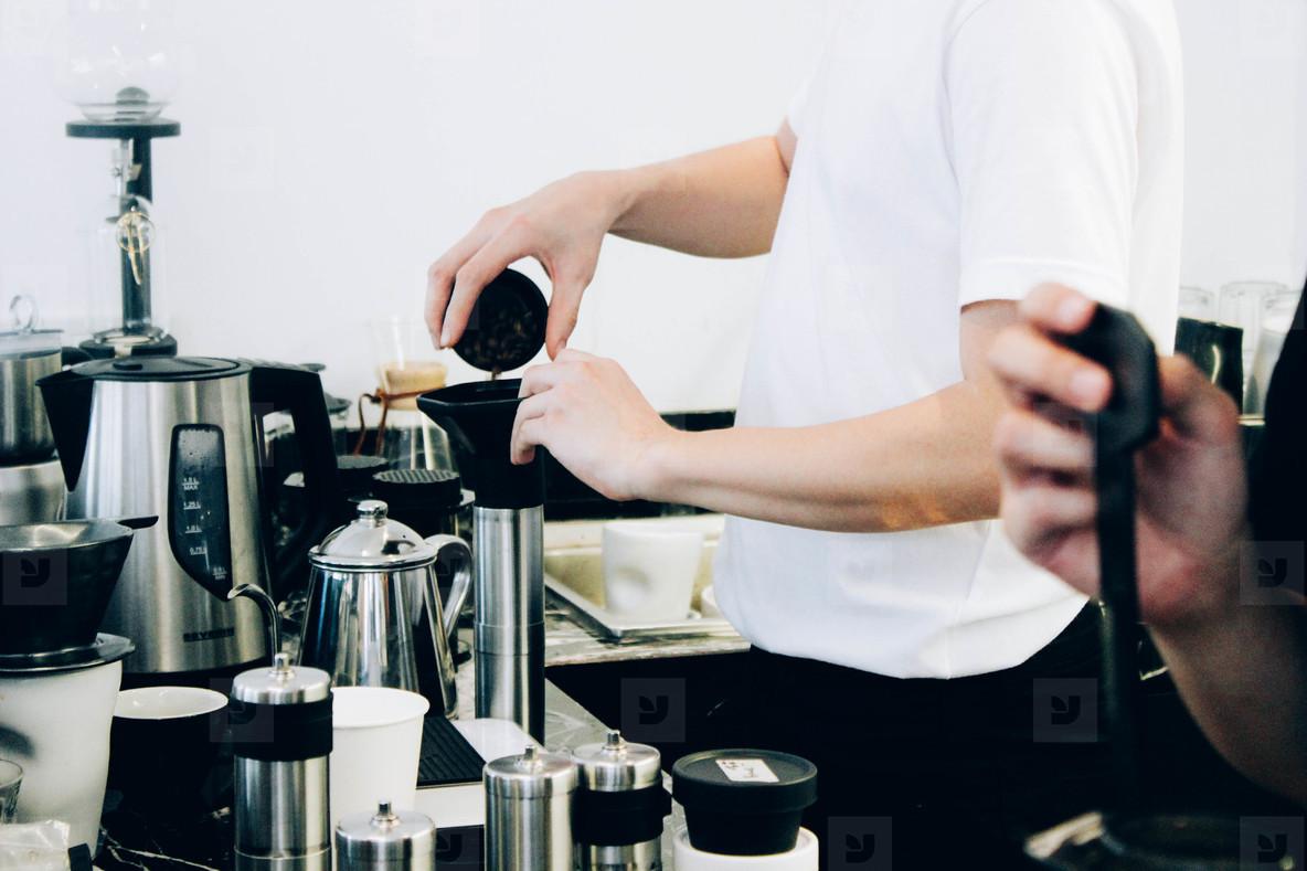 Barista cafe making coffee