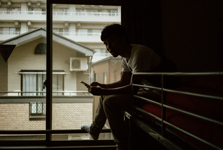 Young male using smartphone