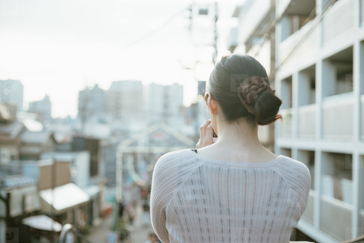 Back side of young woman