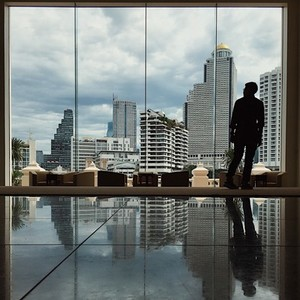 Silhouettes man stand in office