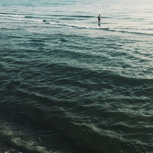 Man stands in the ocean