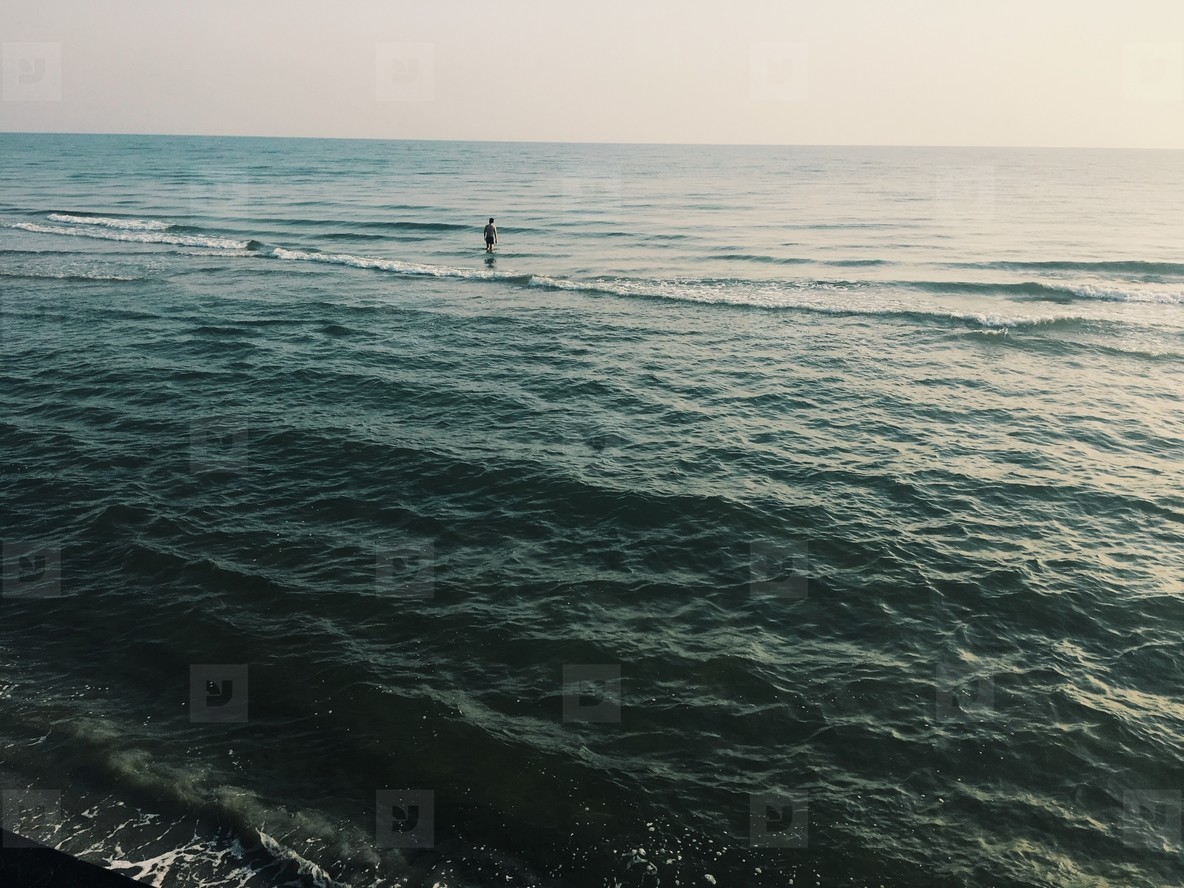 Man stands in the ocean