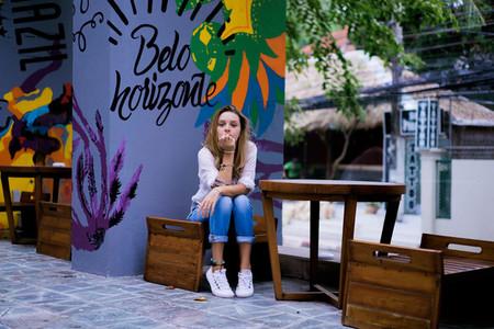 girl in street cafe in Brazil