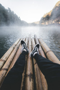 Black sneakers with the lake