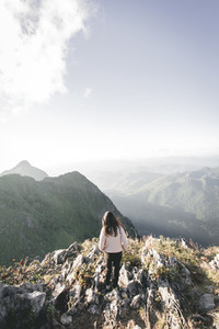 Young girl on the peak