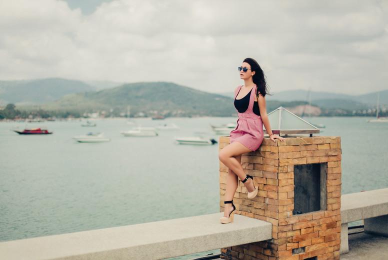 pretty woman posing in the pier