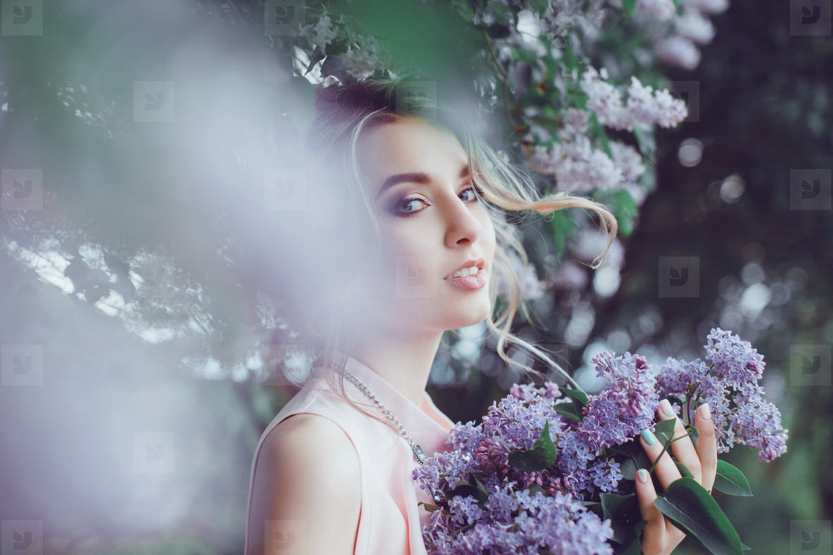 Pretty woman with flowers