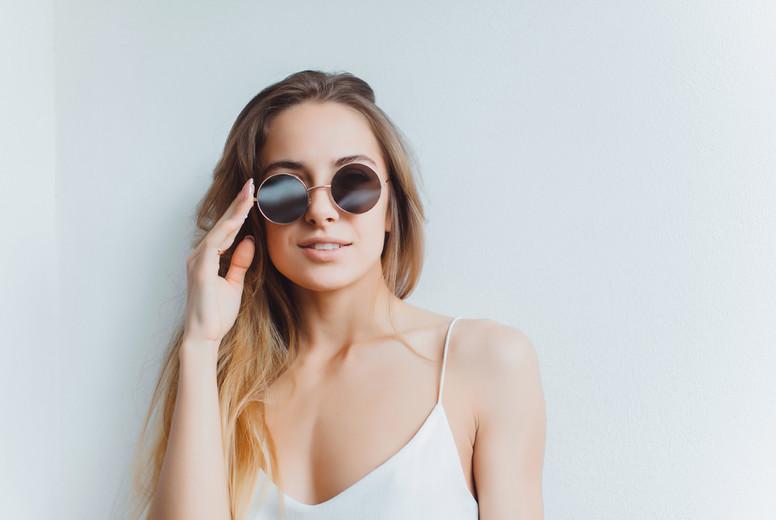 Woman portrait on sunglasses