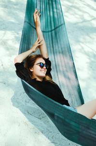 pretty woman posing in hammock