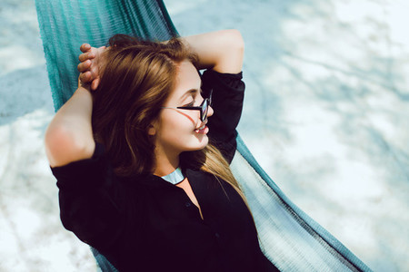 10pretty woman posing in hammock
