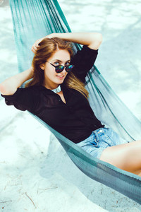 pretty woman posing in hammock