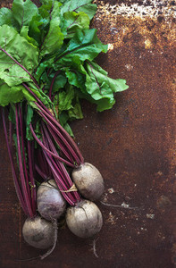 Bunch of fresh garden beetroot over grunge rusty metal backdrop  top view