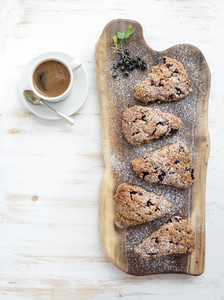 Fresh black currant scones with cup of coffee   top view