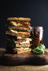 Caprese sandwich or panini  Whole grain bread  mozzarella  cherry and dried tomatoes  basil