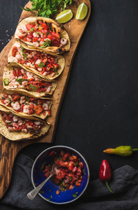 Shrimp tacos with homemade salsa  limes and parsley