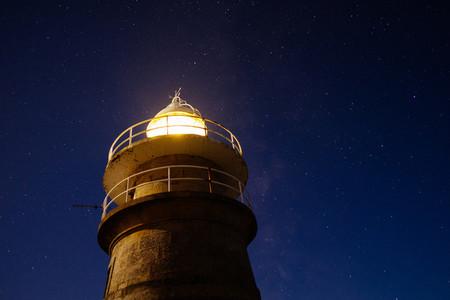 night sky and lighthouse