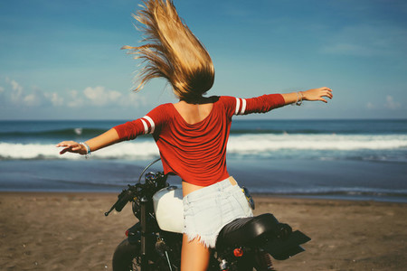 Woman sit on motorcycle