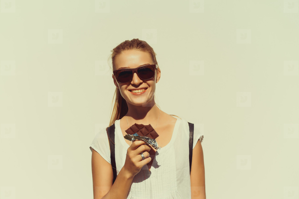 beautiful girl eats chocolate