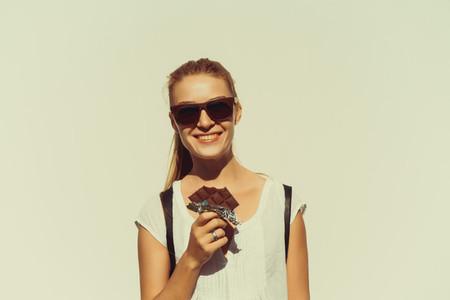 beautiful girl eats chocolate