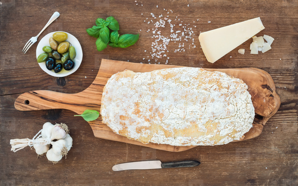 Freshly baked ciabatta bread with garlic  mediterranean olives  basil and Parmesan cheese