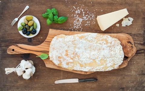 Freshly baked ciabatta bread with garlic  mediterranean olives  basil and Parmesan cheese