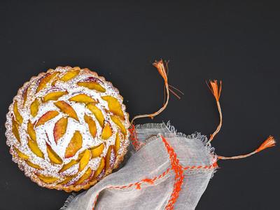 Peach pie with sugar powder