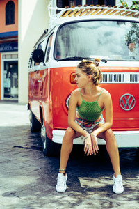 hippie girl near an orange bus