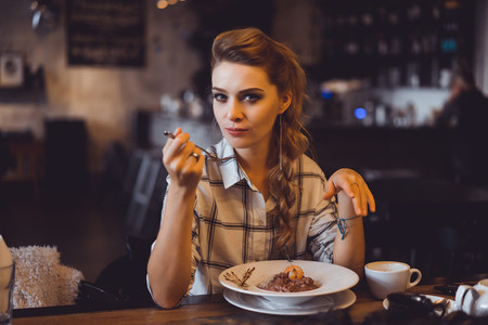 woman having dinner in a cafe
