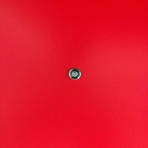 Door lens peephole on red wooden