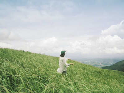Young woman standing on mountain