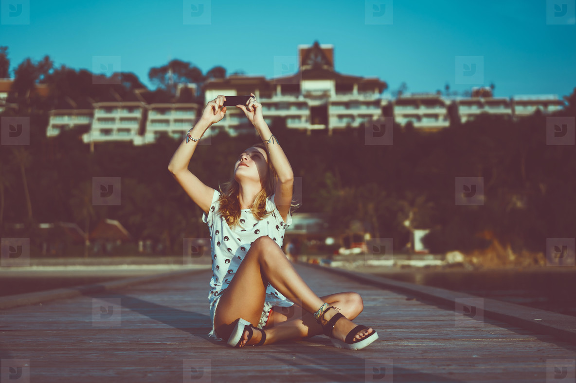 Young cute woman using phone