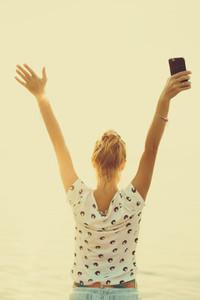 Pretty woman using smartphone