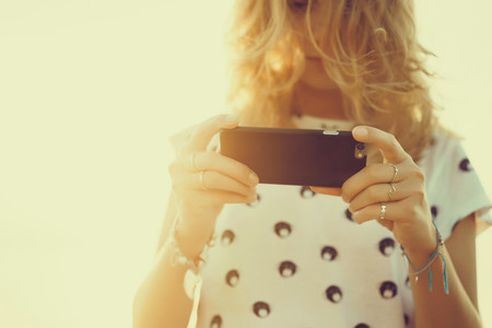 Pretty woman using smartphone