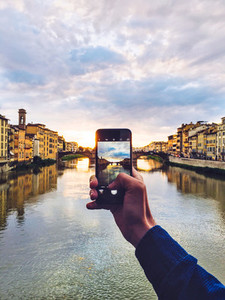 Man holding smartphone for photo
