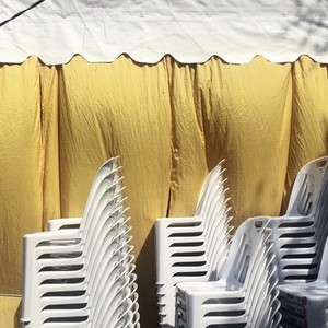 Stacks of plastic white chair