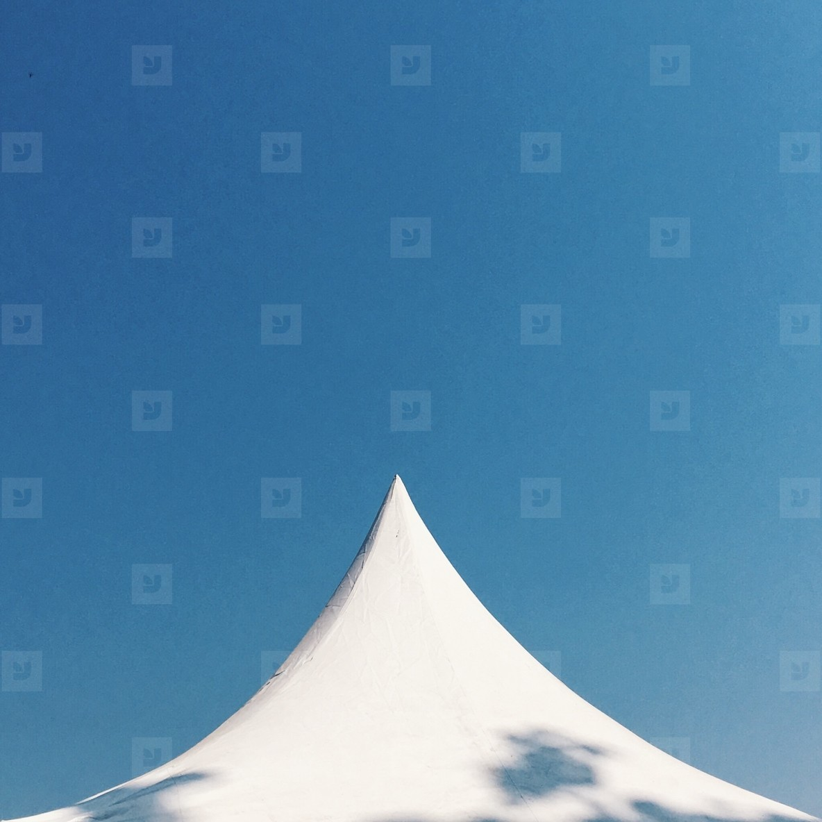 white tent and blue sky