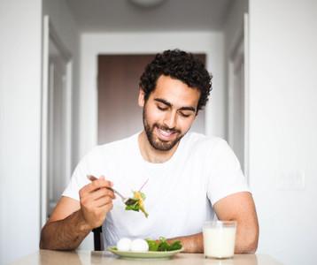 Handsome man having breakfast