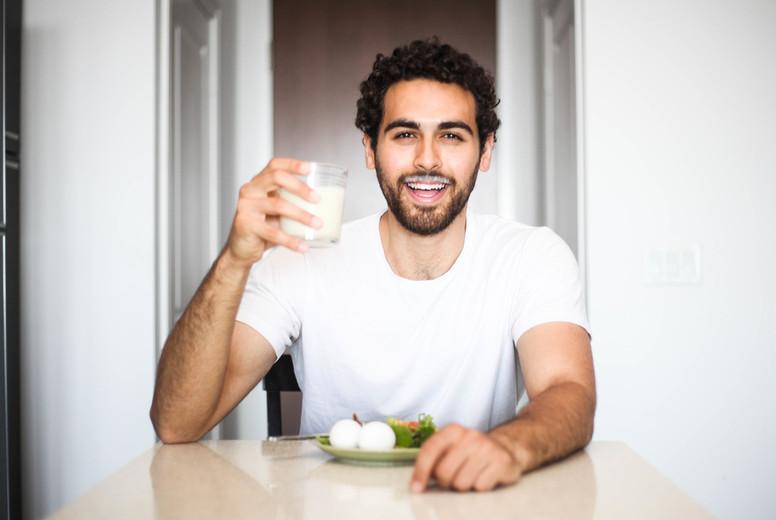 Handsome man drinking fresh milk