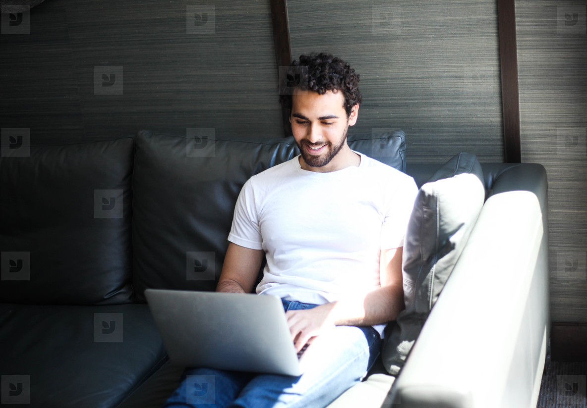 Handsome man working with laptop