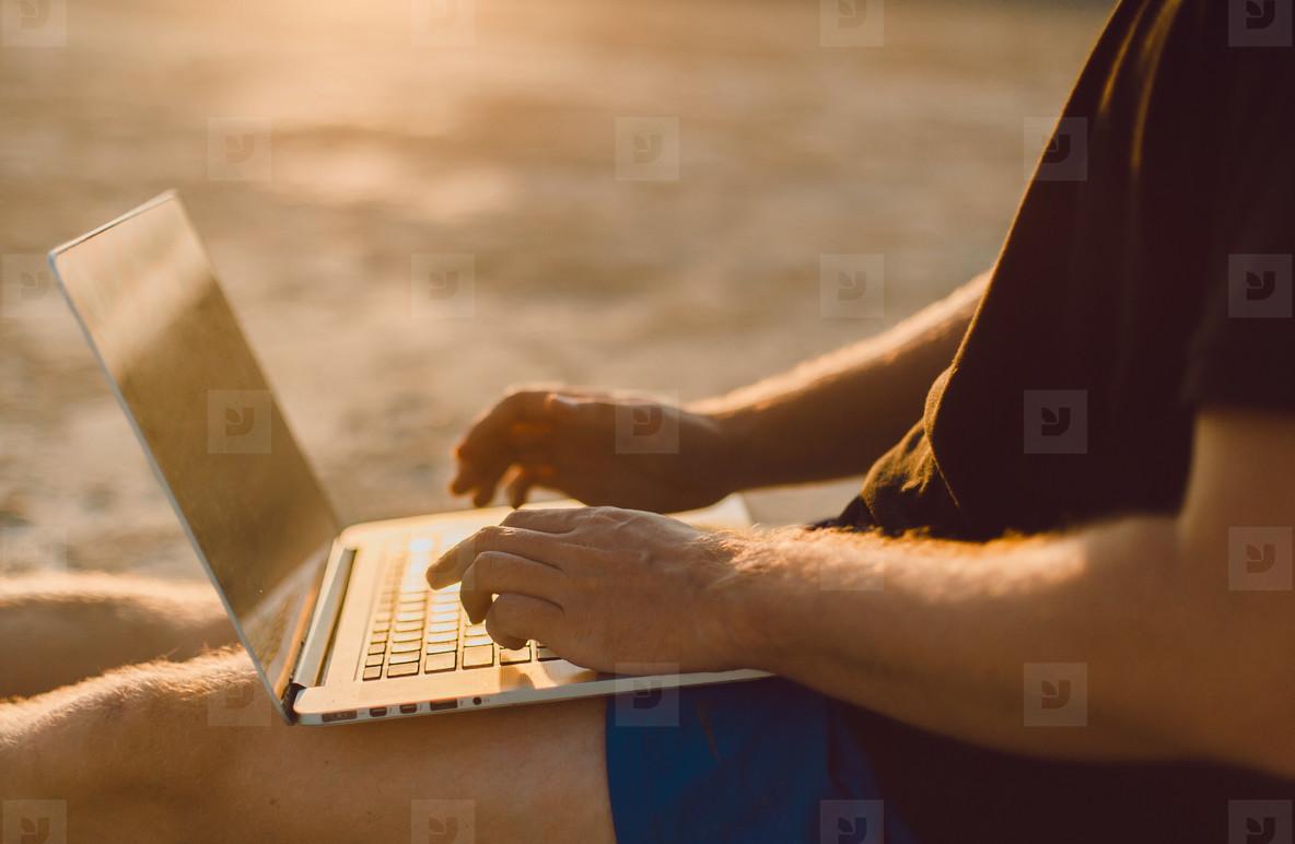 Handsome man using laptop