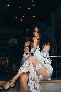 Girl with cigarette in a cafe