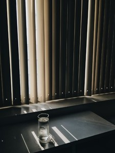 Window blinds with light shining
