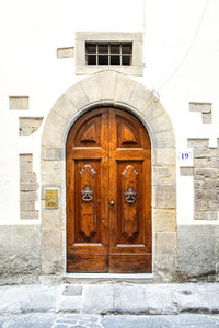 Old Wooden Door with Knockers