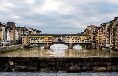 Perspective view of Old Ponte Vecchio Bridge on dull day Florence Italy