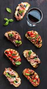 Brushetta set with glass of red wine