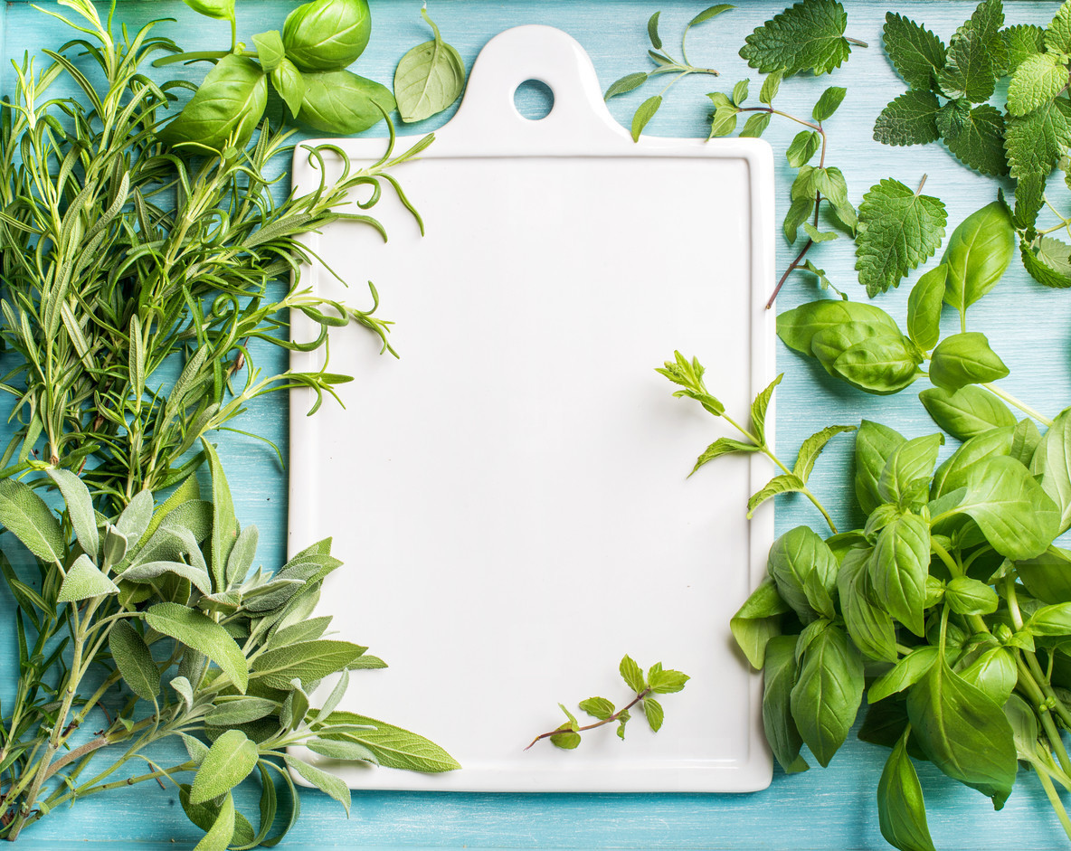 Fresh green cooking herbal assortment  Sage  basil  rosemary  melissa and mint on blue background with copy space