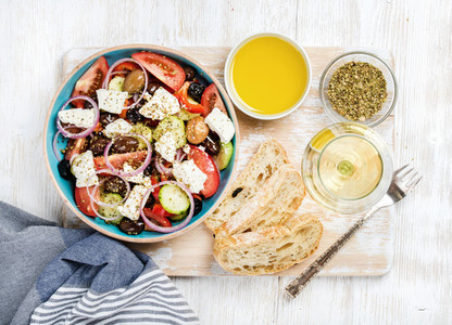 Greek salad with olive oil  bread  spices and white wine